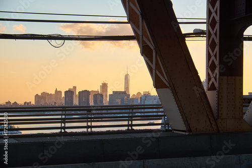 New York City skyline with One World Trade center in the middle seen in the suns плакат