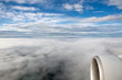 clouds in the sky from airplane window