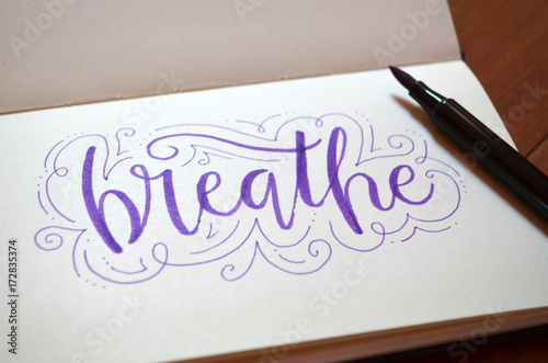 Sticker BREATHE hand-lettered in notepad