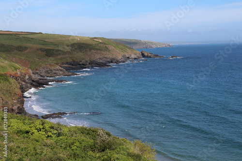 coast of Cornwall with clear blue sea in summer from the south west coastal path Poster