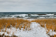 Rough lake and snow covered winter shoreline