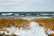 Stormy lake and snow covered winter shoreline