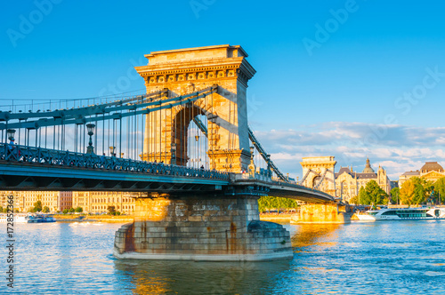 Chain bridge across the Danube river at sunset in Budapest, Hungary