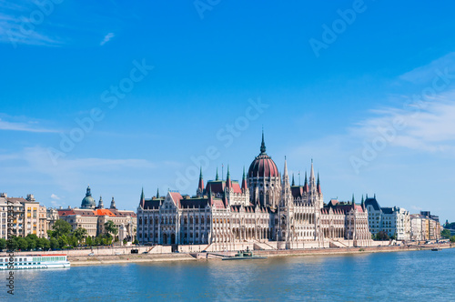 Hungarian Parliament on the embankment of Danube river in Budapest, Hungary Poster