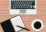 Laptop, notebook with pen and coffee on wooden table