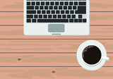 Laptop and coffee on wooden table