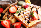 Belgian waffles with strawberries and raspberries, homemade healthy breakfast - 172860941