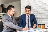 Asian Businessman Present Business Report to Partner in Office - 172861127