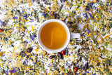Fototapety Tea with colorful herbal mixture