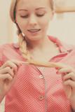 Woman doing braid on blonde hair - 172866742