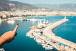 Young man looks at the Alanya port - 172877748