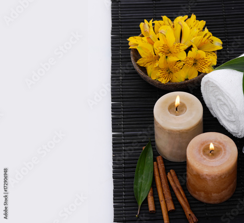 Keuken foto achterwand Spa Spa setting with candle, towel ,orchid, cinnamon on mat