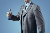 Businessman in gray suit smiling and thumb up - 172945911