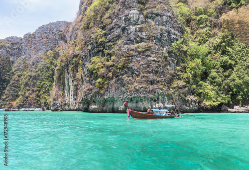 longtail boat moored floating at Pileh bay is blue lagoon with limestone rock at phi phi island in the andaman sea Krabi,Thailand Poster