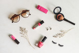 woman cosmetics and fashion items with copy space