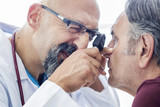 Elderly man examined by an ophthalmologist
