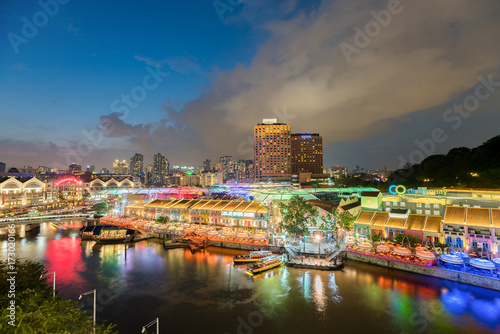 Colorful light building at night in Clarke Quay, Singapore Poster