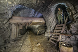 Miner in the underground mine with light in mine Stebnyk, Ukraine - 173042124