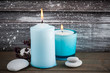 Interior decor with pebbles, blue lit candles