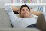 man lying on the sofa - 173072791