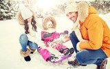 happy family with kid on sled having fun outdoors - 173082115