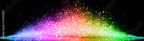 Rainbow of sparkling glittering lights abstract background