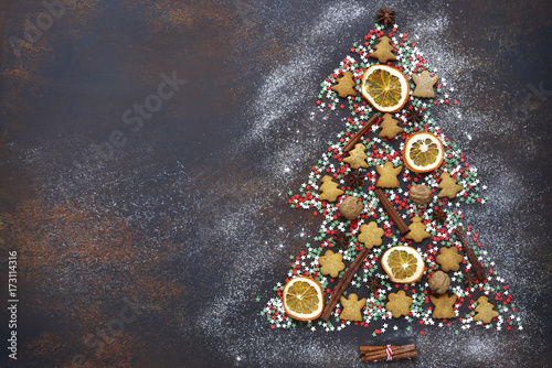 Abstract christmas tree made from festive treats and spices.Top view with copy space. - 173114316