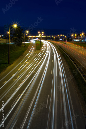 Staande foto Nacht snelweg Light trails from cars in Riga city. Long exposure photograph at night