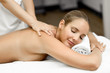 Leinwanddruck Bild Young blonde woman having massage and smiling in the spa