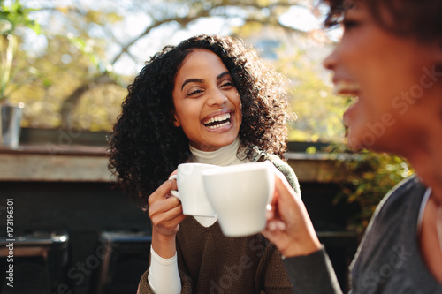 Two women drinking coffee at a coffee shop