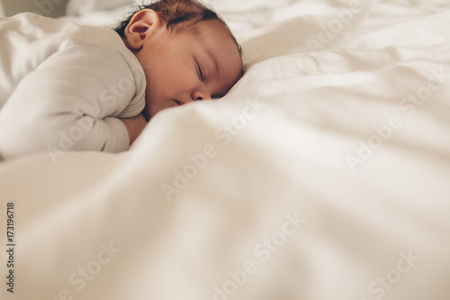 Little boy sleeping peacefully in bed