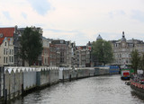 amsterdam and the navigable canal called SINGEL with floating fl - 173203125