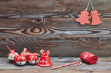 Christmas decoration hanging on wooden background - 173264396