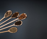 A variety of exotic spices in wooden spoons, top view - 173282785