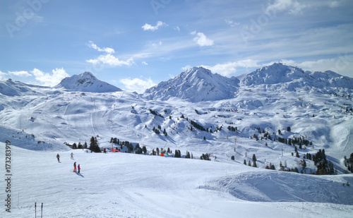 obraz lub plakat Wide snowy slopes in high mountains in La Plagne ski resort, Alps, France