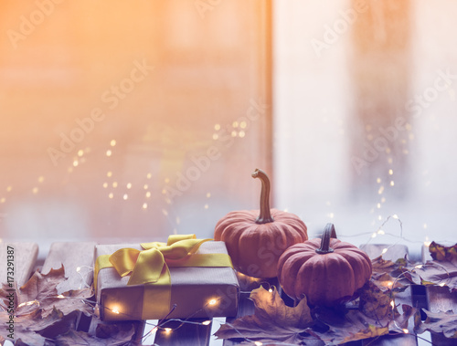 pumpkin and gifts with maple leaves and Fairy Lights