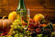 Pumpkins, grapes and apples. grape wine and bright. close-up. holiday halloween