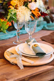 perfection, romance, design concept. tidy fltatware for celebration of wedding with knife and fork strapped of lilar thin ribbon, set of plates, two high aesthetic wineglasses - 173299327