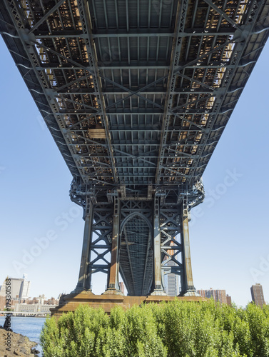 Under the Manhattan Bridge early in the morning with blue sky and sun shine - Br Poster