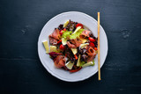 Vegetable salad and diced meat. On a wooden background. Top view. Free space. - 173303113