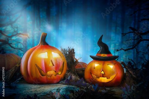 Halloween pumpkinlanterns in a mystic forest