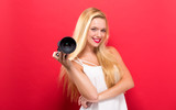Young woman comparing professional camera on a solid background - 173343930