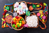 colorful candies, jellies, lollipops, marshmallows  and marmalade, top view