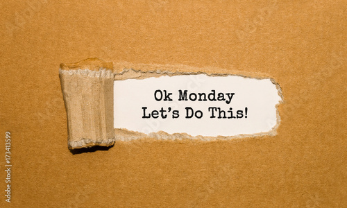 The text Ok Monday Lets Do This appearing behind torn brown paper