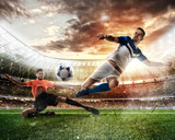Football scene with competing football players at the stadium - 173417759