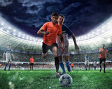 Football scene with competing football players at the stadium - 173425702
