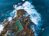 Aerial view of North Curl Curl rockpool with surrounding waves. - 173427329