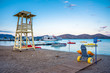 Quadro Lifeguard tower with beach wheel chair for disabled swimmers, Elounda, Crete, Greece.