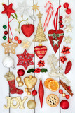 Christmas bauble decorations with gold joy sign, holly, mistletoe, gingerbread biscuits, dried orange fruit and mince pie on rustic white wood background. - 173437344