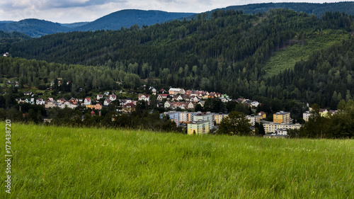 Staande foto Grijze traf. View on the landscape with city Kraslice in Krusne hory Czech republic. Hills with forests in the background.